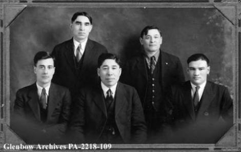 Alberta Metis Association, Edmonton, Alberta. Front row, L-R: Malcolm Frederick Norris, Edmonton; Joseph Francis Dion, Gurneyville; James Patrick Brady, Lac La Biche. Back row, L-R: Peter Cecil Tomkins, Grouard; Felix Callihoo, St. Paul. (Image from http://www.albertaonrecord.ca/is-glen-2241)